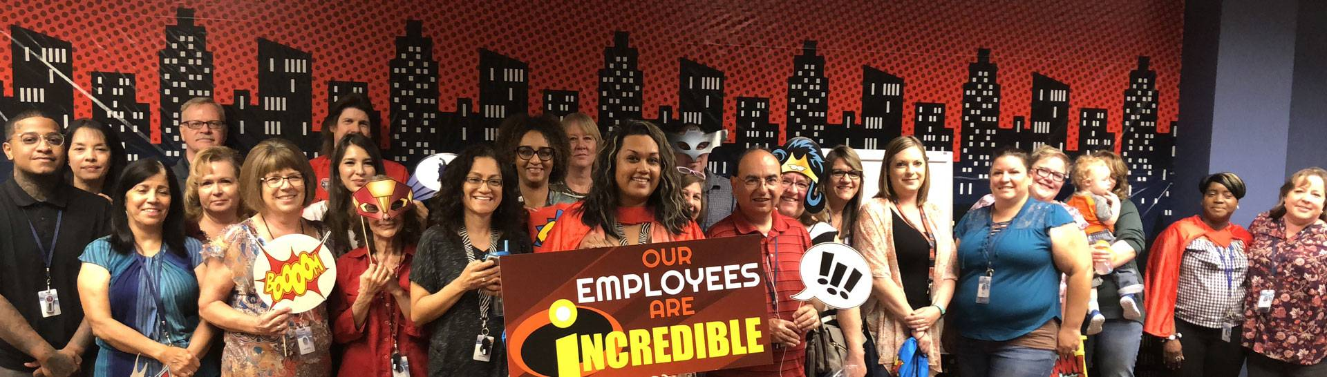 NMEAF Employees holding sign that says Our Employees are Incredible