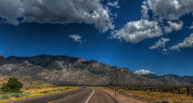 NM road with mountains and sky